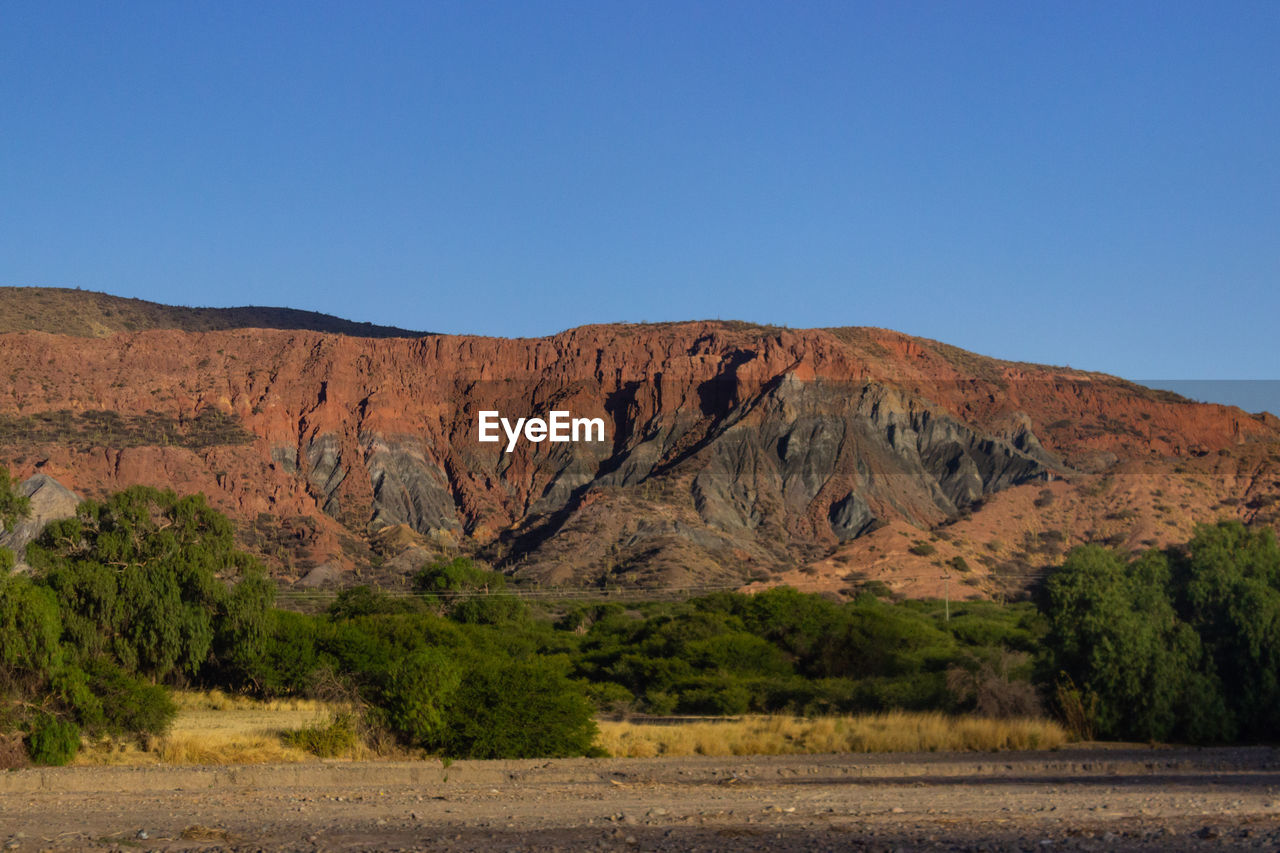 scenics - nature, environment, sky, tranquil scene, beauty in nature, rock, landscape, nature, clear sky, tranquility, land, non-urban scene, mountain, no people, rock - object, remote, plant, solid, blue, day, climate, outdoors, formation, arid climate, eroded