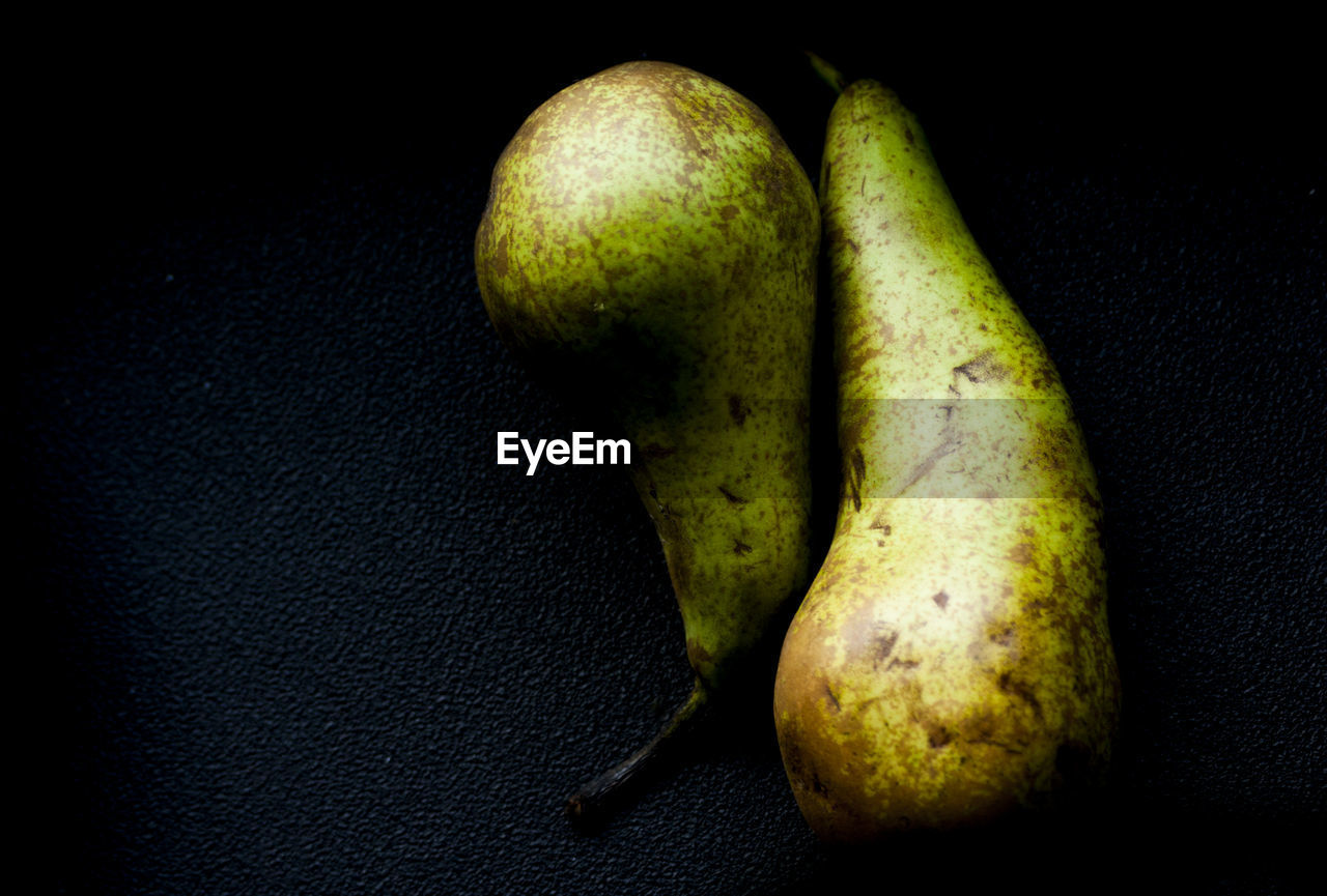 High Angle View Of Pears Against Black Background