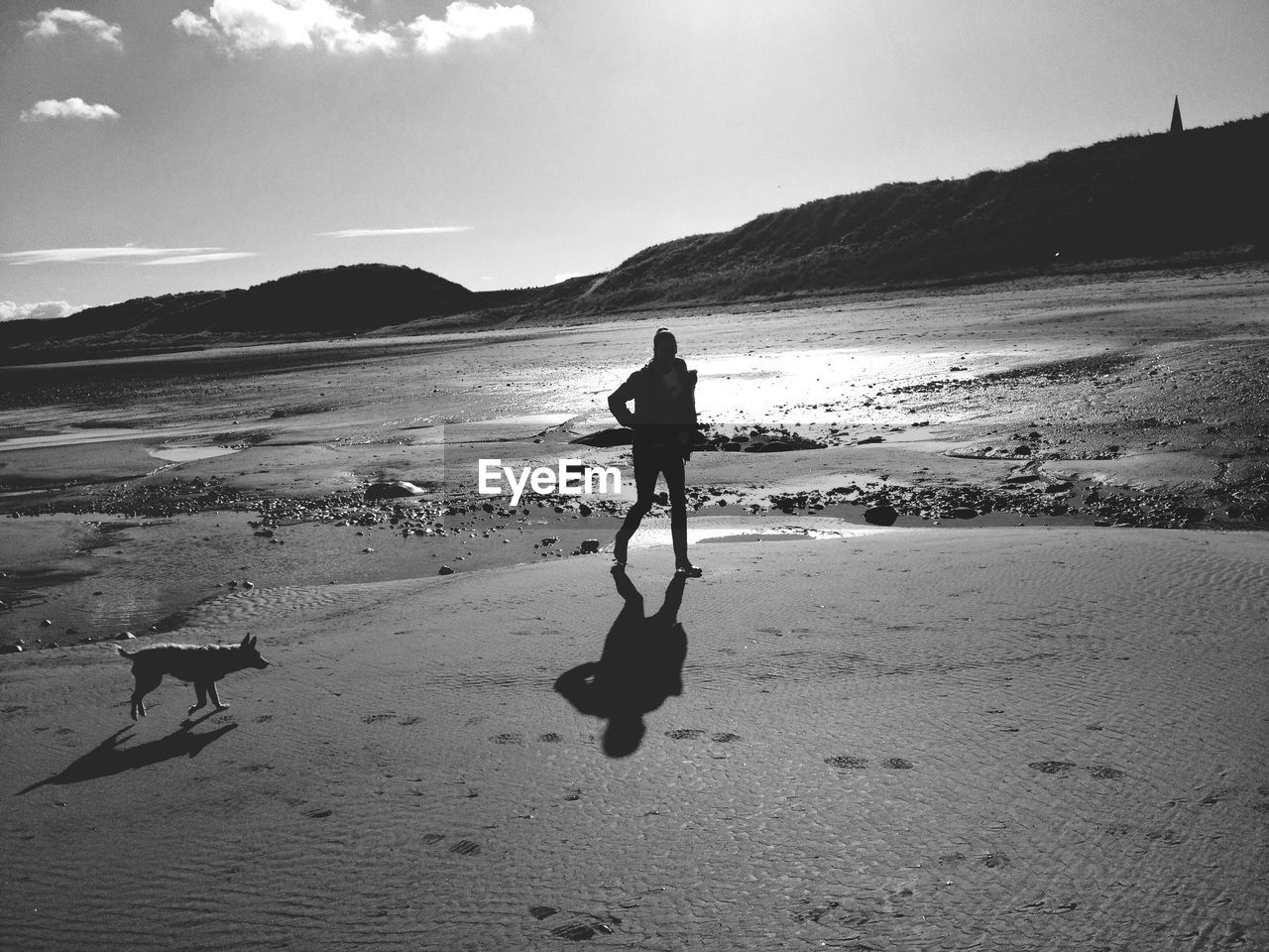 beach, real people, sea, sand, shore, one person, nature, full length, leisure activity, men, walking, day, lifestyles, water, sky, vacations, outdoors, adventure, standing, scenics, shadow, mountain, extreme sports, beauty in nature, wave, horizon over water, one man only, people