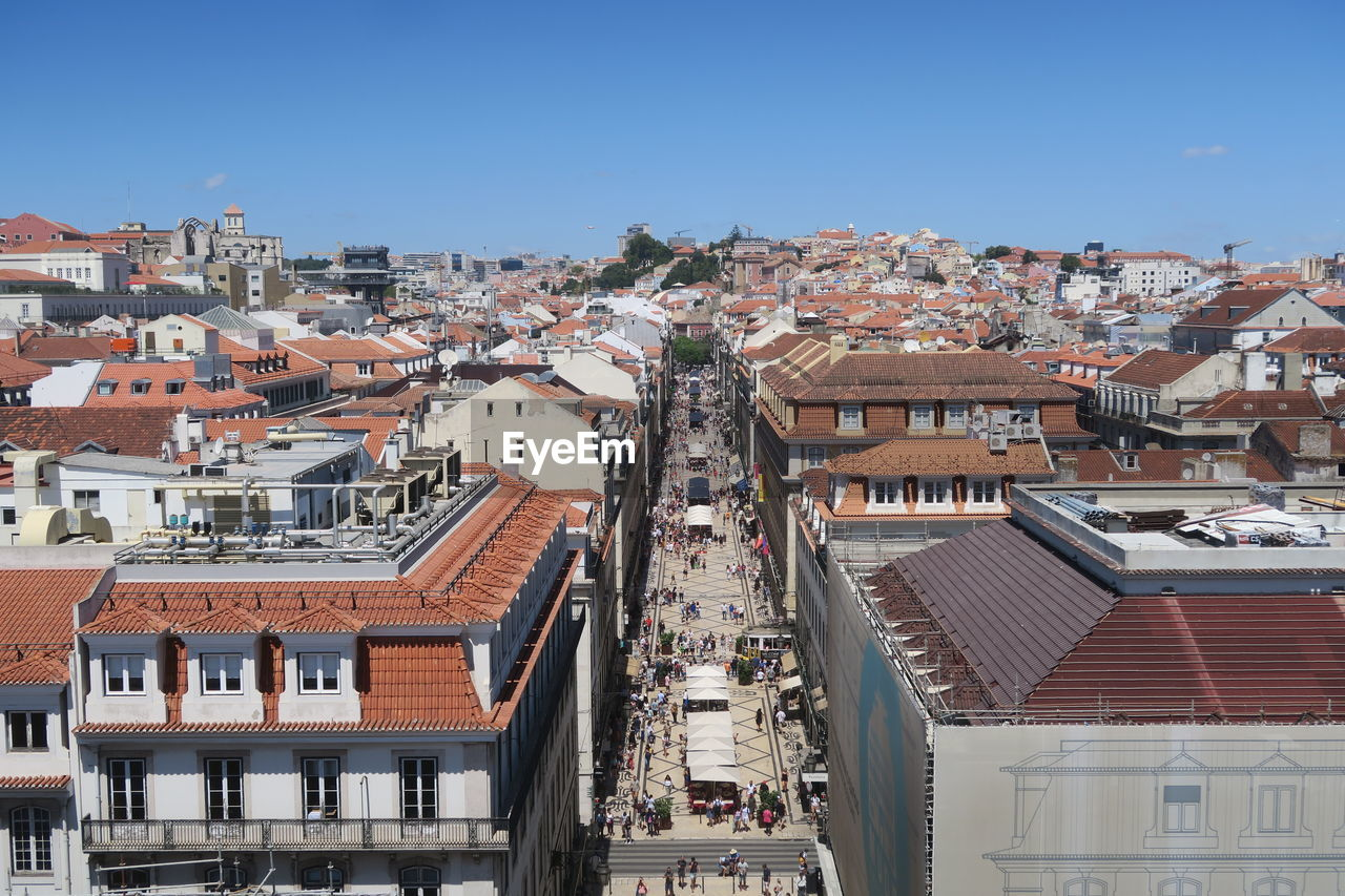 High Angle View Of Townscape Against Clear Blue Sky During Sunny Day