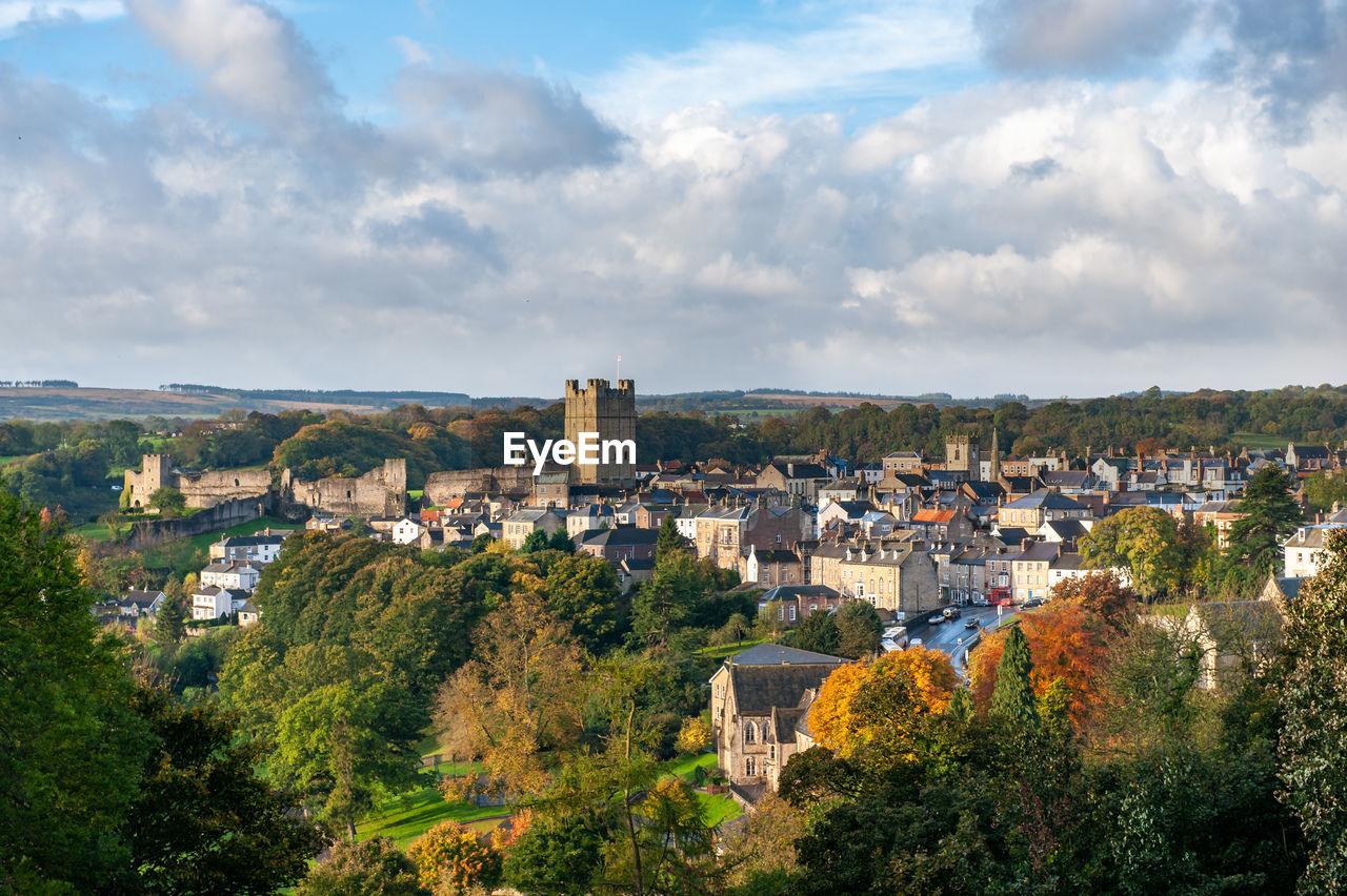 View of richmond castle, north yorkshire with the town in the foreground and autumn colours