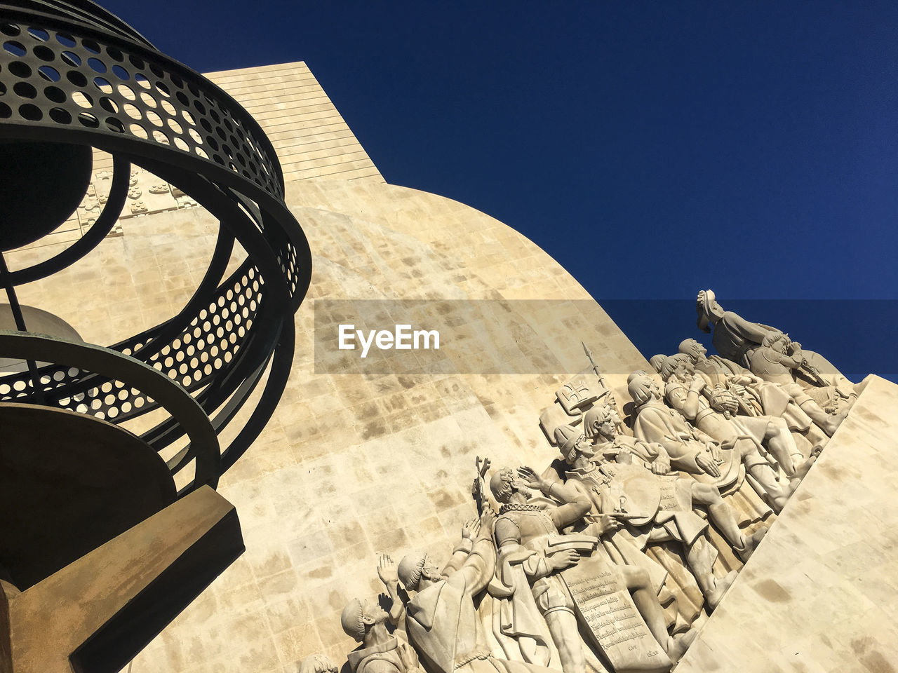 sky, architecture, nature, no people, art and craft, blue, sunlight, sculpture, clear sky, built structure, day, travel destinations, creativity, tourism, statue, outdoors, representation, low angle view, human representation, pattern
