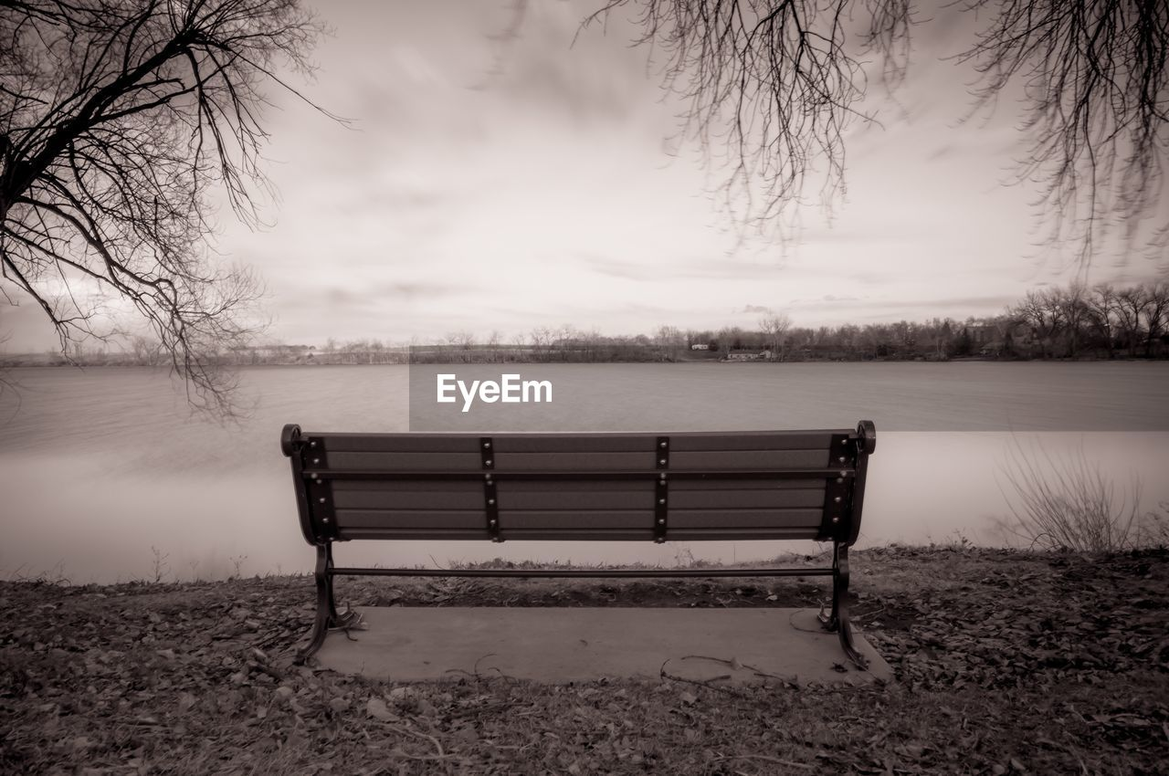 bench, lake, tranquility, nature, absence, beauty in nature, no people, tranquil scene, tree, scenics, water, sky, outdoors, bare tree, day