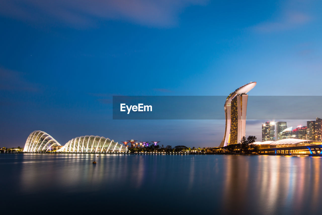 architecture, built structure, bridge - man made structure, waterfront, city, connection, sky, water, river, travel destinations, building exterior, cityscape, illuminated, night, modern, outdoors, no people, skyscraper, urban skyline