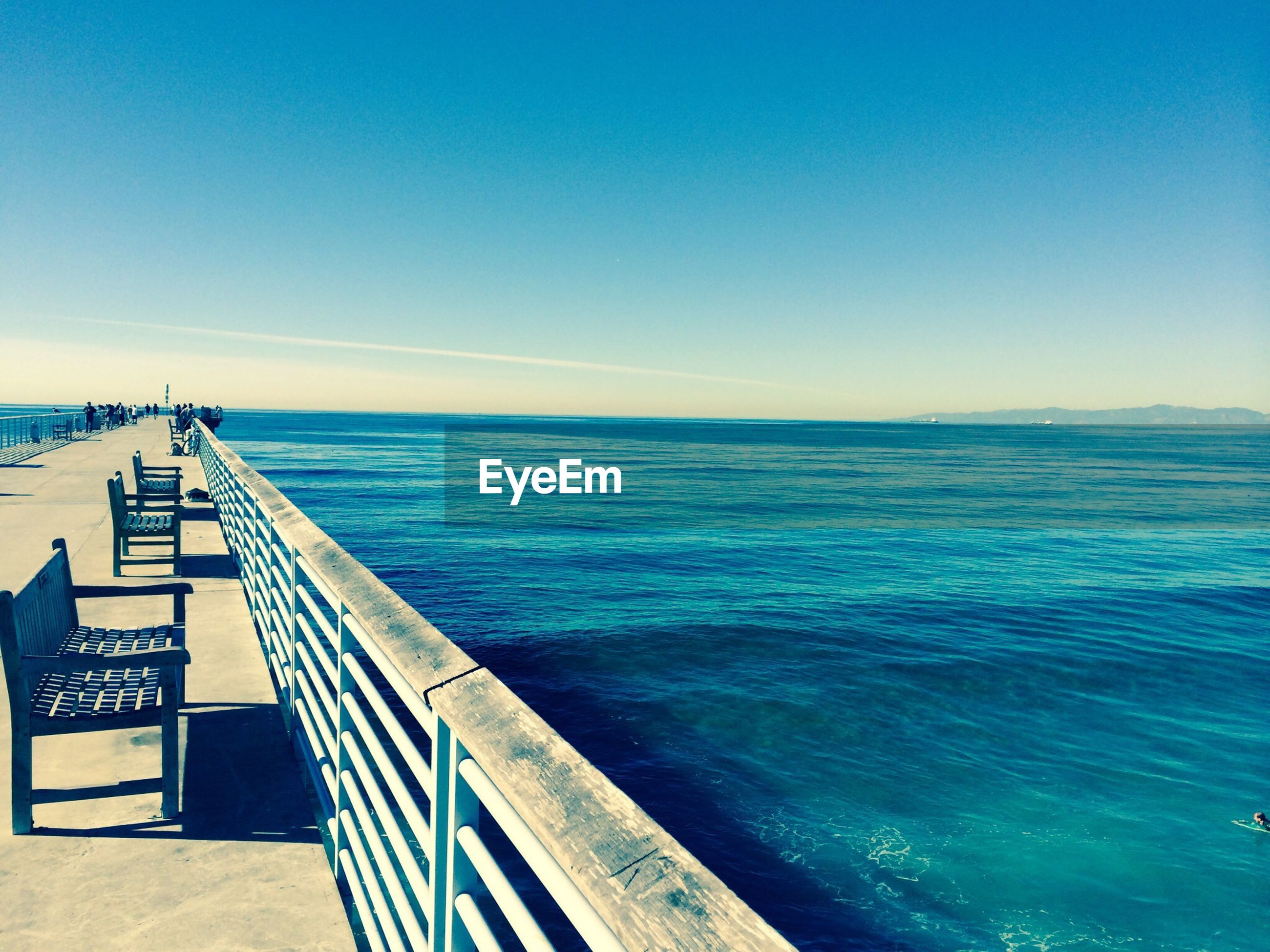 sea, water, blue, horizon over water, tranquil scene, tranquility, scenics, beauty in nature, pier, nature, copy space, sky, railing, clear sky, idyllic, beach, seascape, ocean, day, rippled