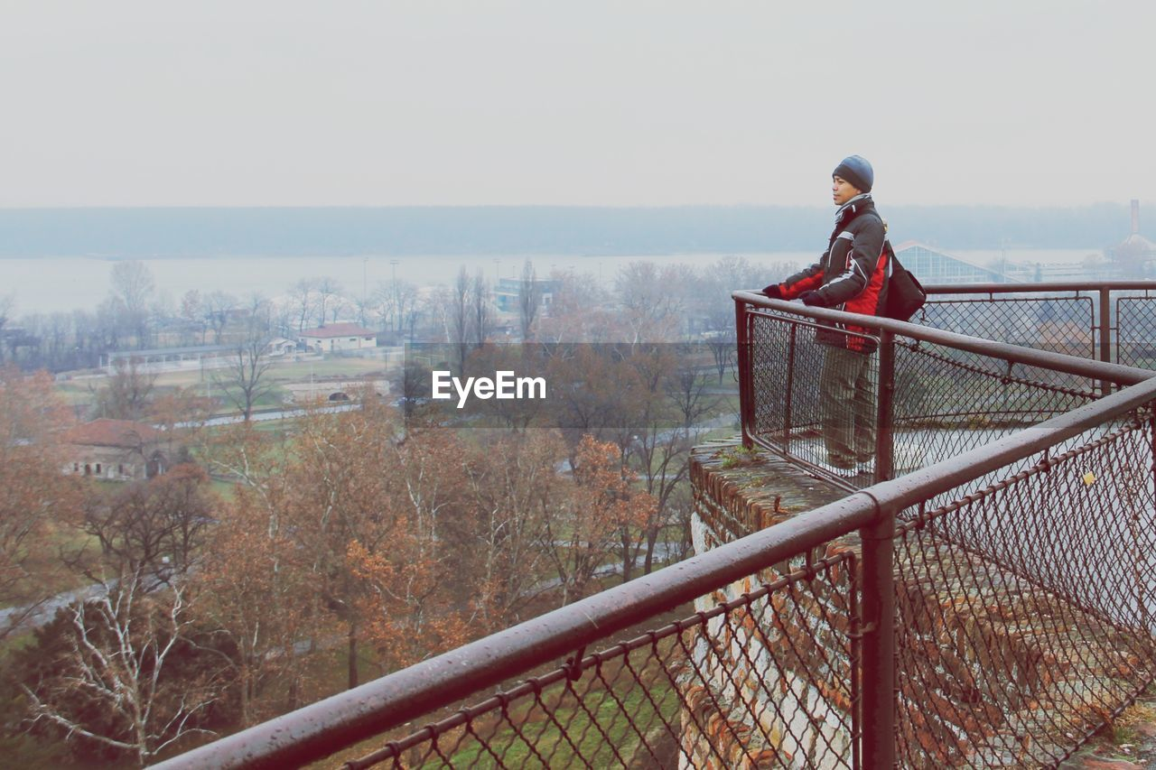 Man standing at observation point during autumn