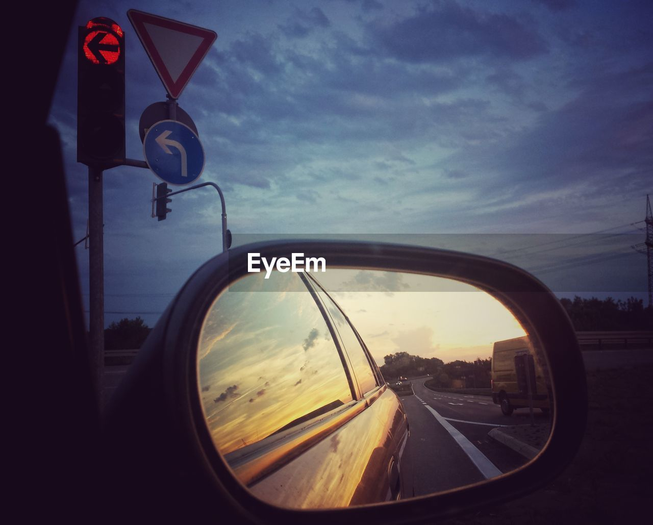 transportation, sky, sign, cloud - sky, road, land vehicle, mode of transportation, motor vehicle, car, side-view mirror, reflection, nature, mirror, glass - material, road sign, sunset, no people, communication, street, city, guidance, outdoors, vehicle mirror, light, road trip