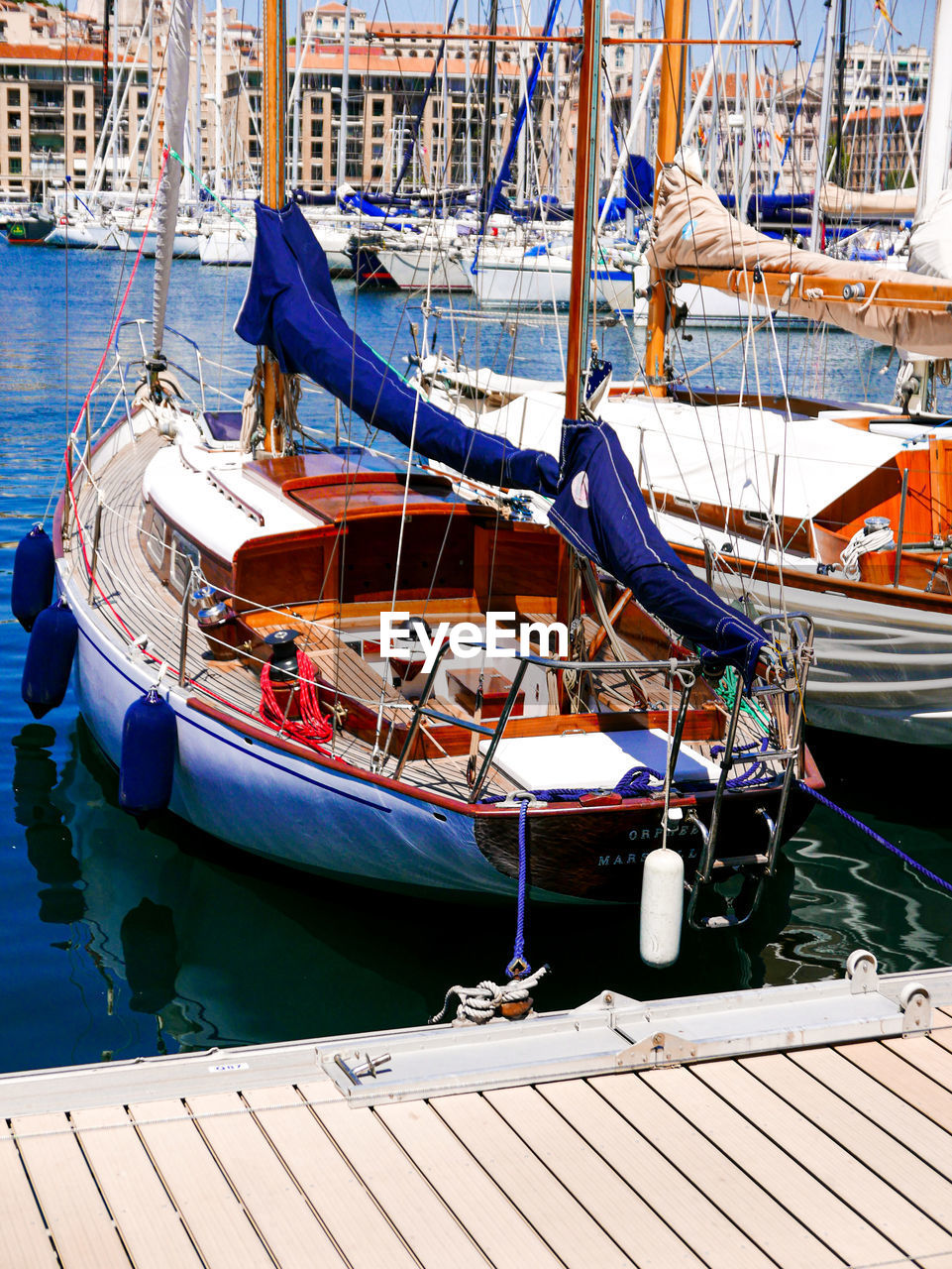 nautical vessel, mode of transportation, water, transportation, moored, rope, day, nature, no people, harbor, outdoors, sea, wood - material, sunlight, travel, blue, sailboat, pier, sailing, yacht, fishing boat, rigging