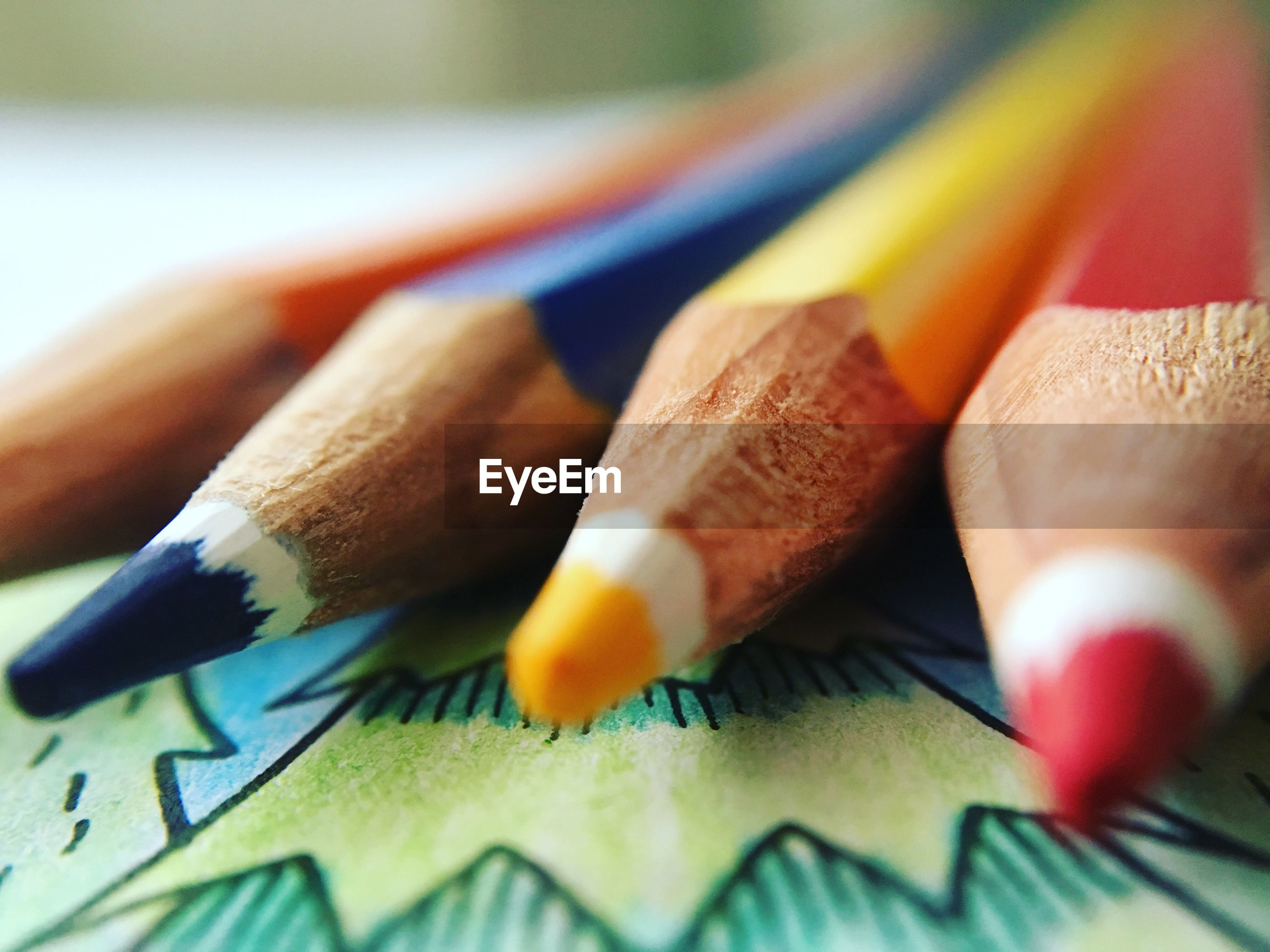 indoors, close-up, still life, selective focus, multi colored, table, paper, art and craft, creativity, pencil, art, book, colorful, education, variation, focus on foreground, high angle view, no people, colored pencil, detail