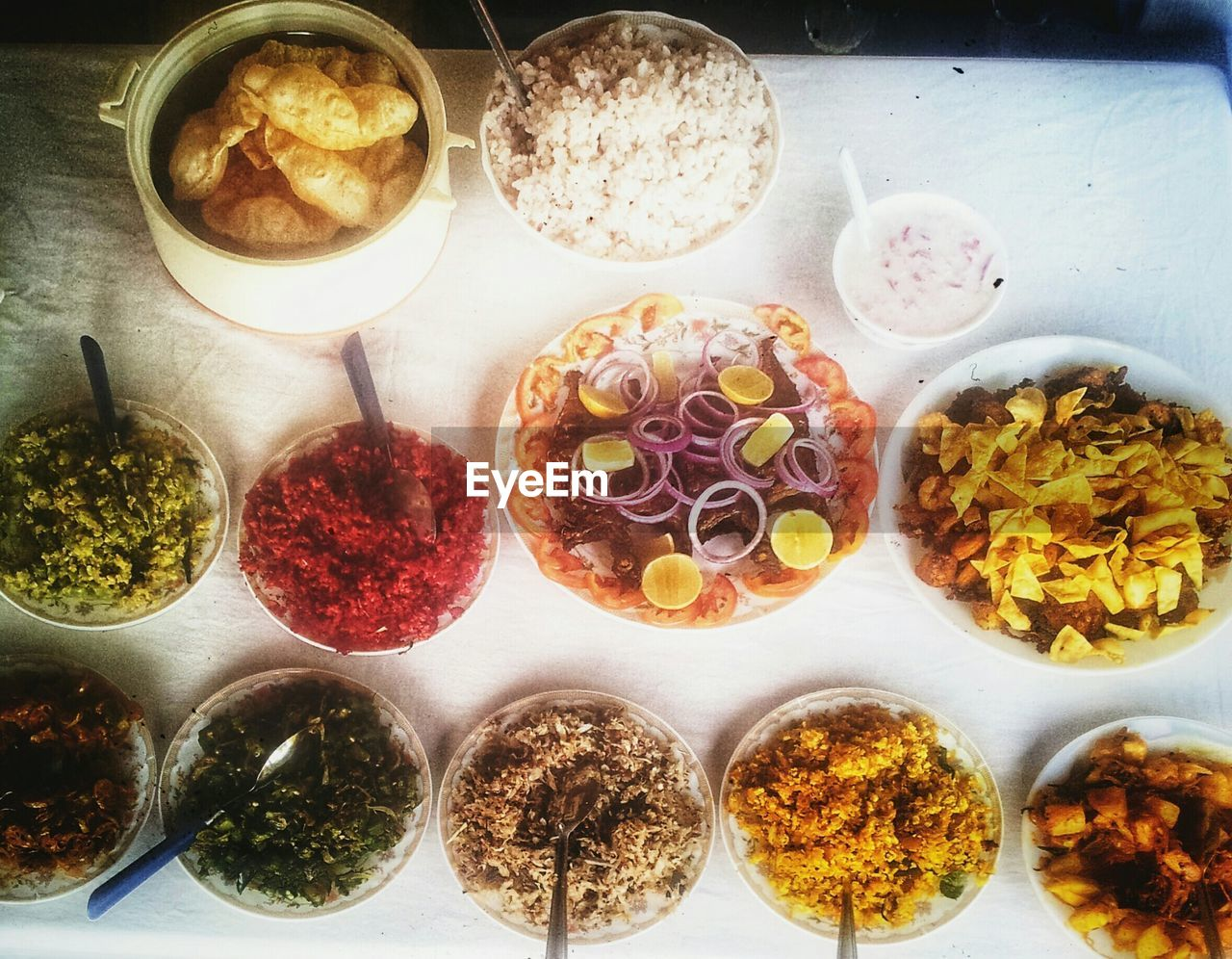 High Angle View Of Indian Food Served On Table