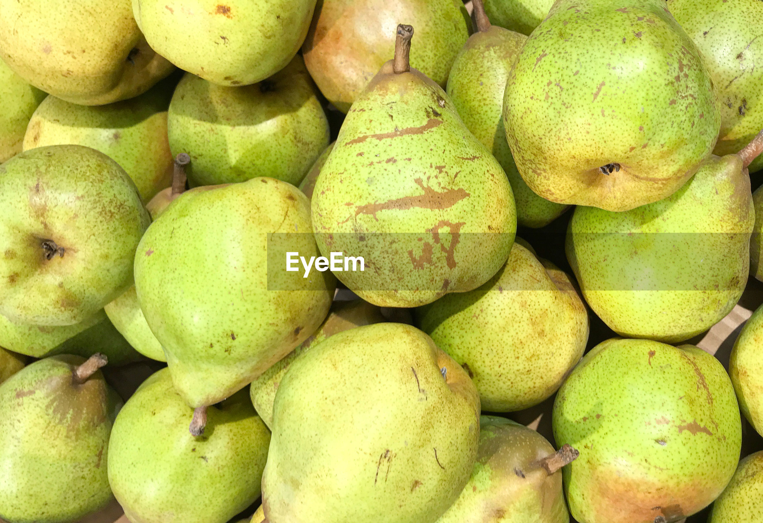 Close-up of pears on the market