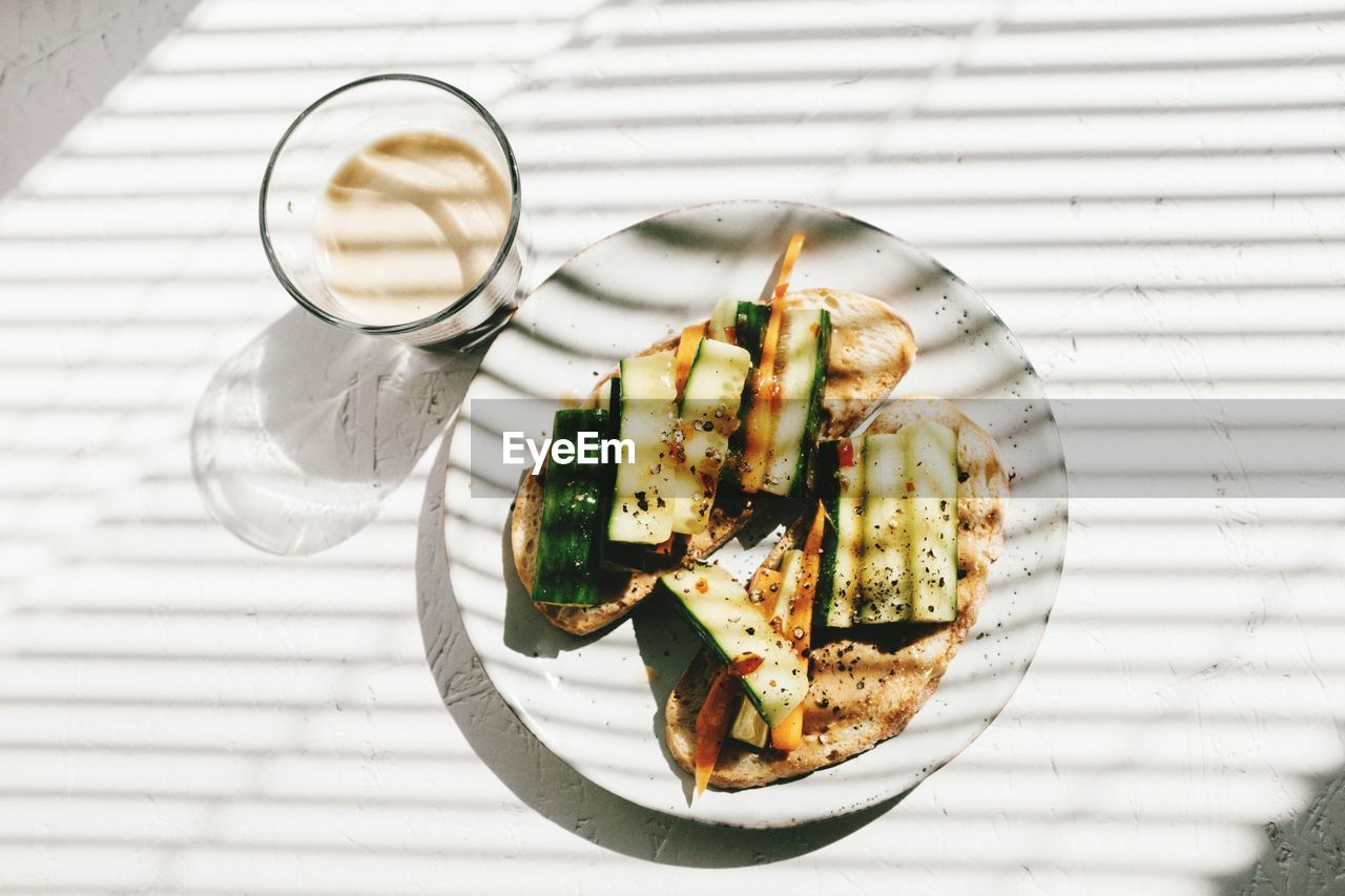 food, food and drink, ready-to-eat, freshness, healthy eating, table, wellbeing, plate, indoors, vegetable, no people, still life, directly above, high angle view, serving size, close-up, indulgence, focus on foreground, eating utensil, vegetarian food, glass, temptation, garnish, snack