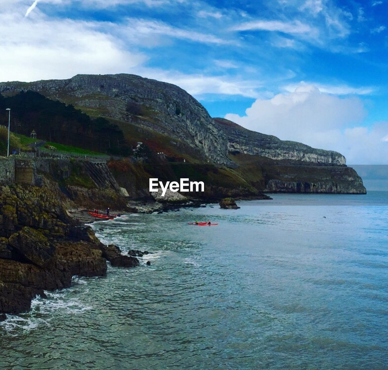 scenics, nature, sky, beauty in nature, mountain, water, sea, tranquil scene, tranquility, outdoors, cloud - sky, rock - object, waterfront, day, no people, travel destinations, physical geography, cliff