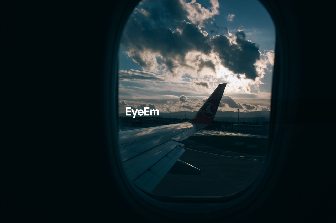 airplane, transportation, air vehicle, window, cloud - sky, journey, mode of transport, sky, travel, airport, no people, airplane wing, aircraft wing, flying, commercial airplane, day, indoors, sunset, runway, close-up, nature