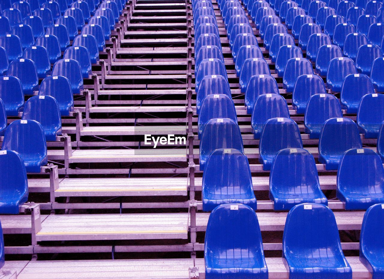 Blue Empty Chairs Arranging In Stadium