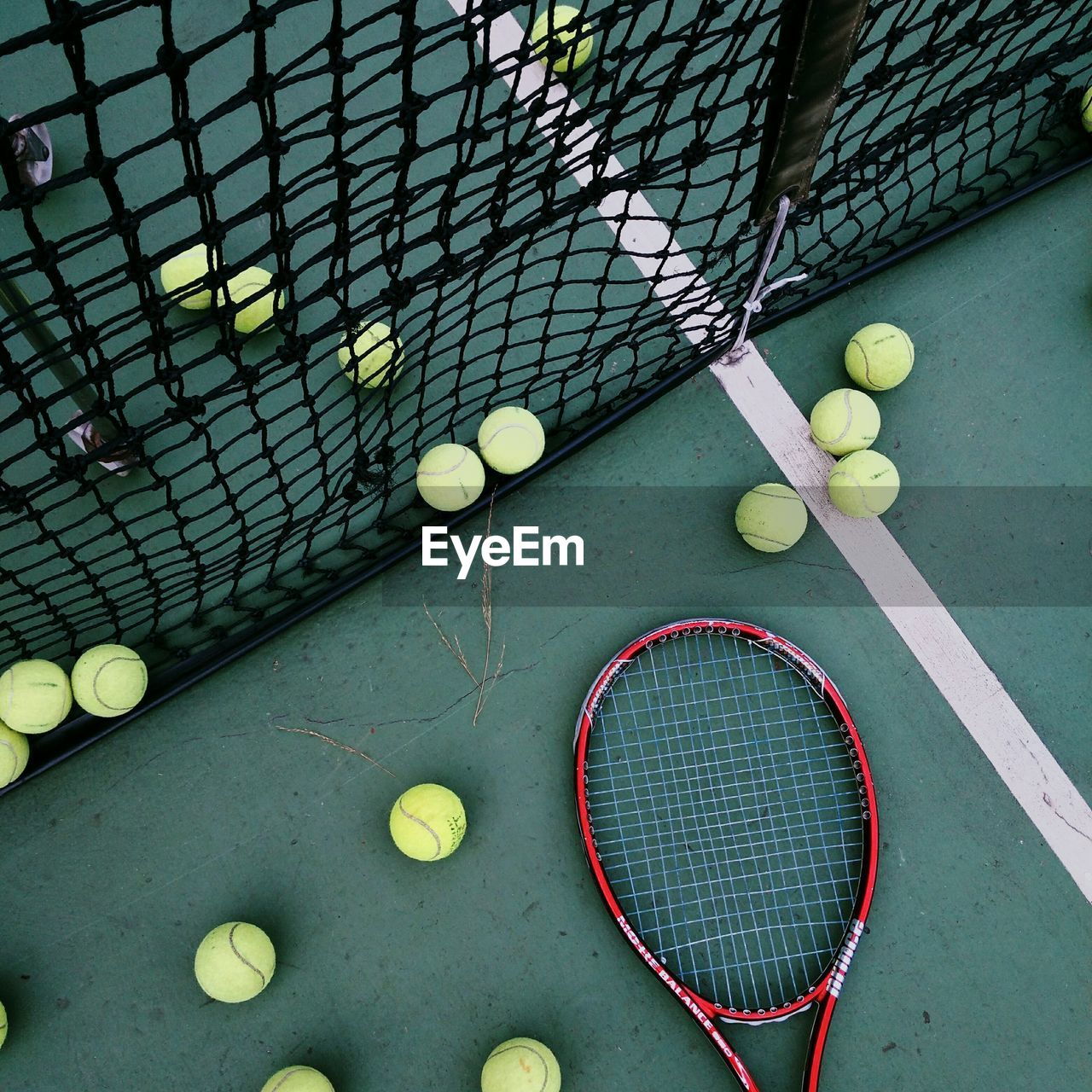 High angle view of rackets and balls at court