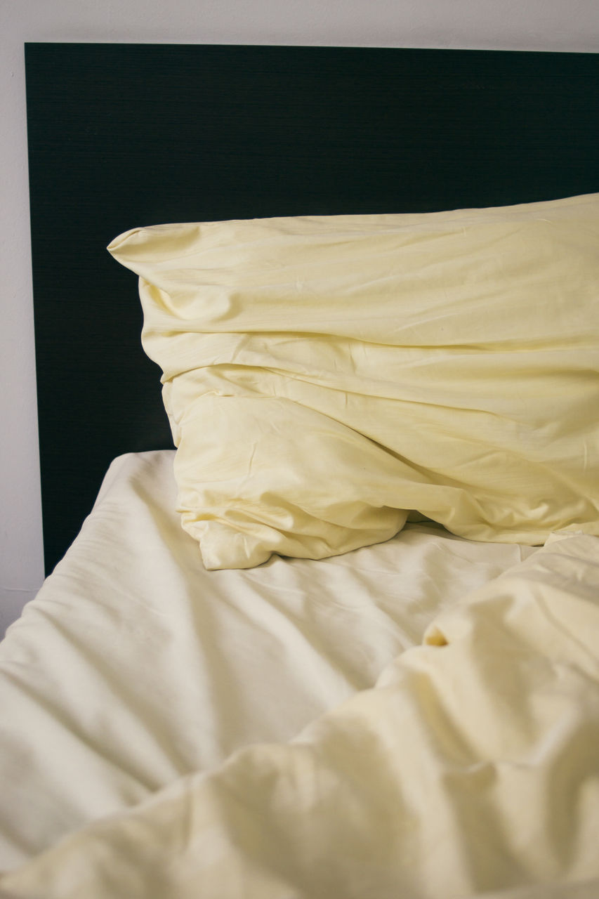 Close-Up Of Pillow On Bed In Hotel Room