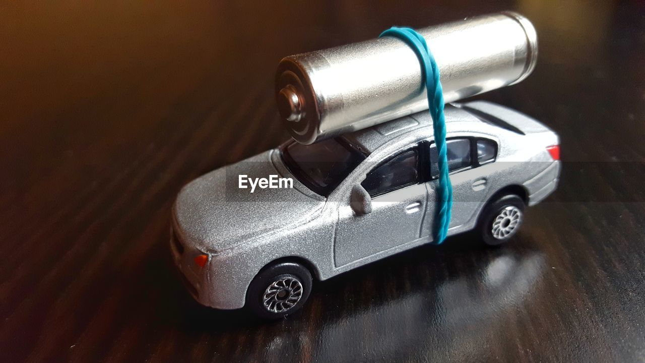 Close-Up Of Battery On Toy Car At Table