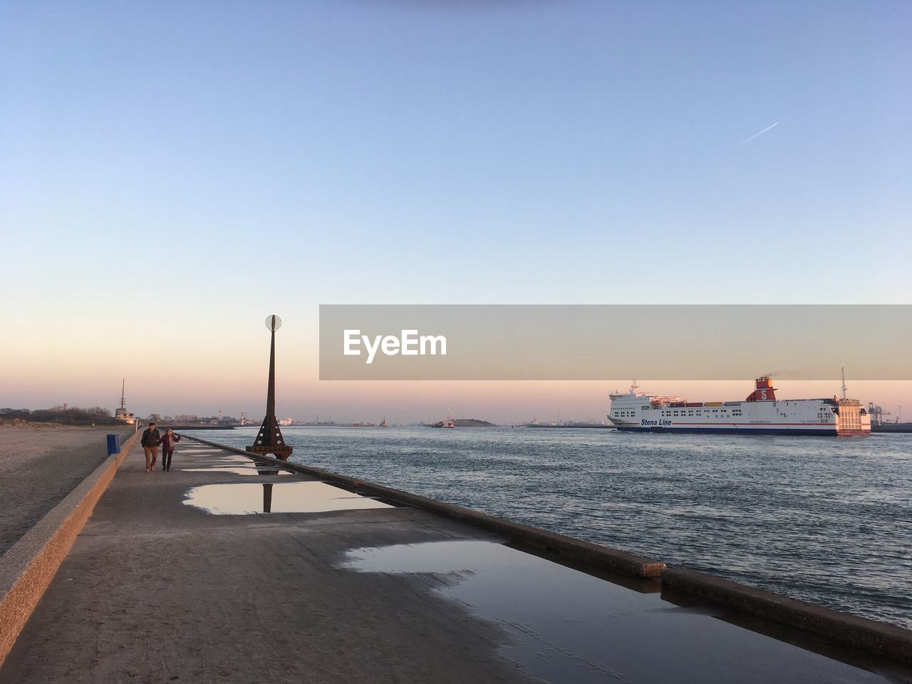 water, sky, transportation, sea, nautical vessel, mode of transportation, sunset, copy space, clear sky, nature, incidental people, scenics - nature, architecture, beauty in nature, outdoors, pier, built structure, road, travel
