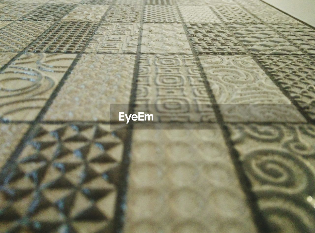 full frame, selective focus, no people, indoors, pattern, backgrounds, close-up, day