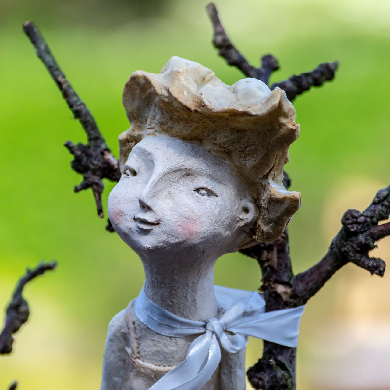 representation, human representation, sculpture, statue, close-up, creativity, art and craft, no people, focus on foreground, day, plant, female likeness, nature, tree, male likeness, craft, outdoors, growth, emotion, selective focus, angel