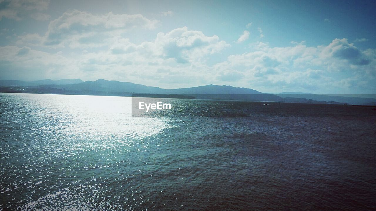 scenics, tranquility, sea, water, beauty in nature, tranquil scene, nature, sky, mountain, no people, outdoors, day, mountain range, landscape