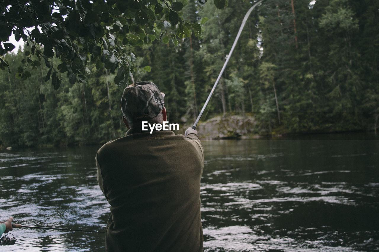 Rear View Of Man Fishing