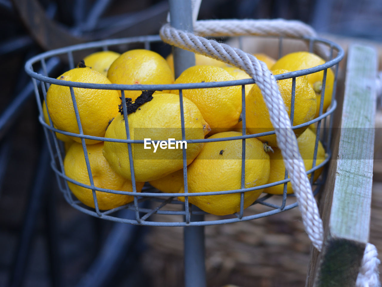 yellow, container, focus on foreground, close-up, no people, fruit, basket, food, healthy eating, freshness, day, food and drink, wellbeing, outdoors, still life, metal, lemon, rope, group, citrus fruit