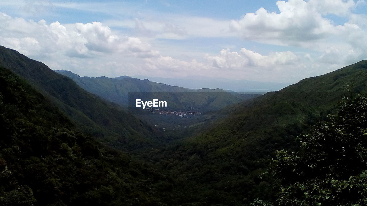 mountain, nature, beauty in nature, sky, landscape, tranquil scene, tranquility, day, scenics, outdoors, no people, tree