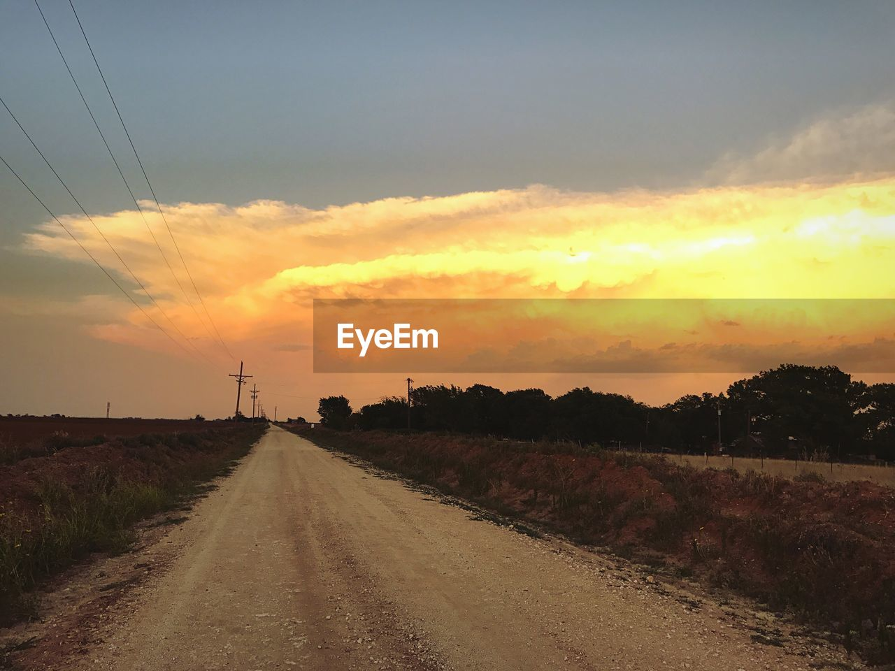 sunset, cable, sky, electricity pylon, the way forward, power line, nature, no people, road, landscape, connection, scenics, tranquil scene, power supply, field, fuel and power generation, tranquility, cloud - sky, outdoors, beauty in nature, electricity, rural scene, telephone line, day, tree
