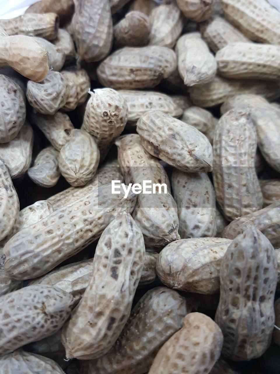 Full frame shot of peanuts for sale at market