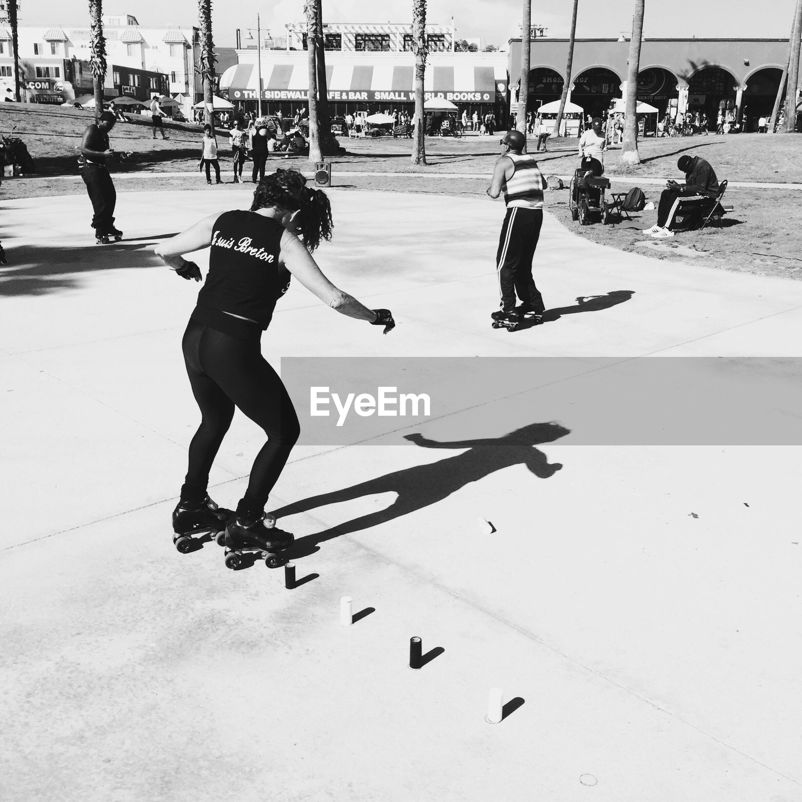 lifestyles, large group of people, leisure activity, men, street, person, full length, walking, city life, fun, shadow, sport, city, road, enjoyment, sunlight, togetherness, motion, performance