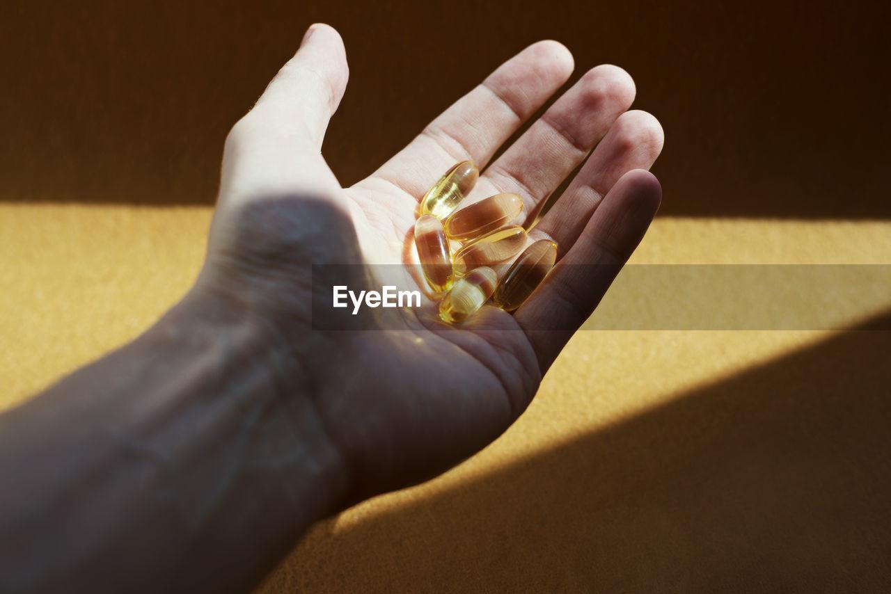 Close-up of human hand holding pills