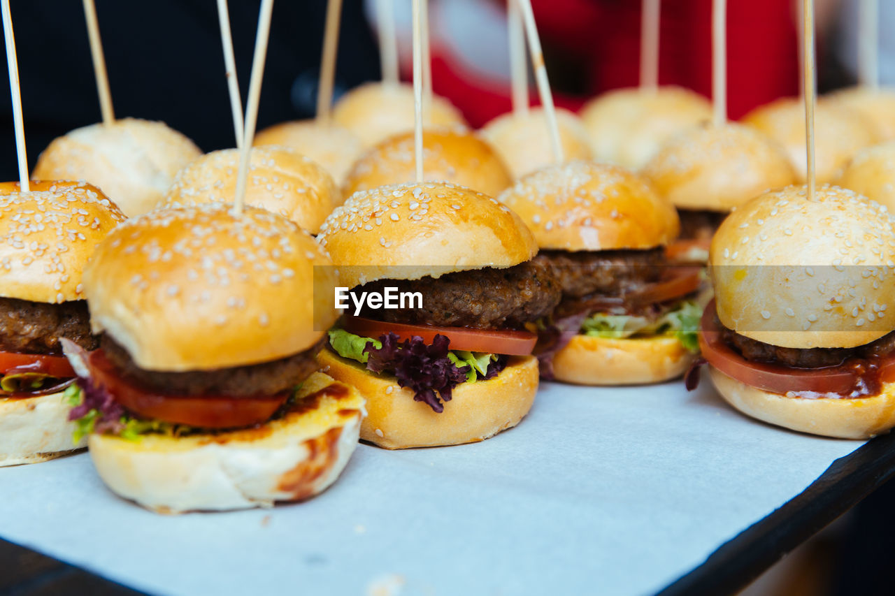 fast food, unhealthy eating, ready-to-eat, burger, food and drink, sandwich, food, hamburger, freshness, indoors, close-up, still life, meat, bread, no people, indulgence, table, bun, take out food, selective focus, snack, cheeseburger, tray, temptation