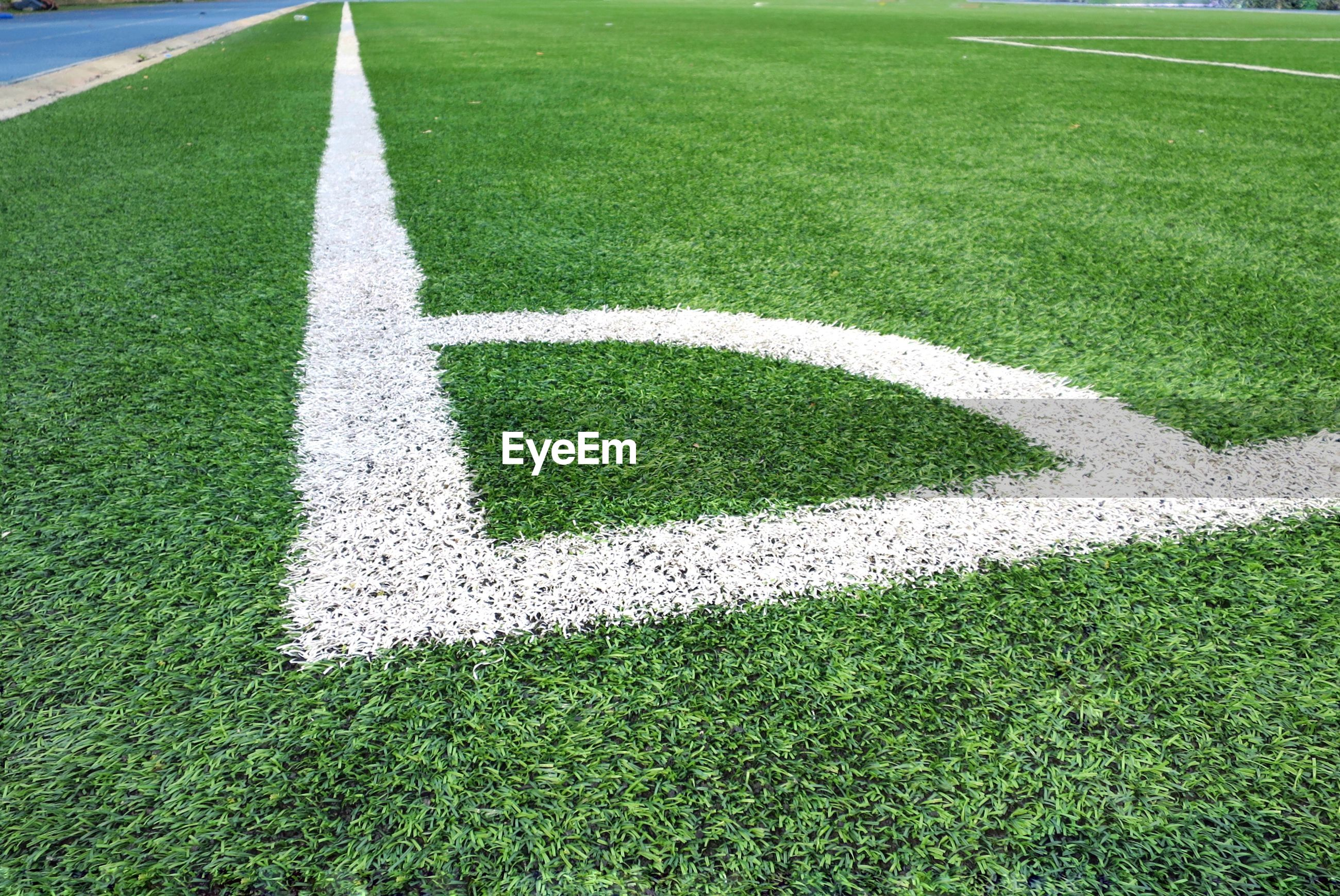Corner soccer field or football field texture background. white lines on green grass.