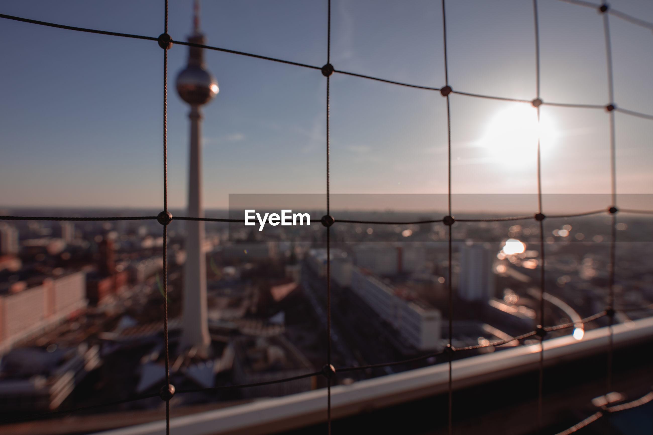 SCENIC VIEW OF SUNSET THROUGH WINDOW