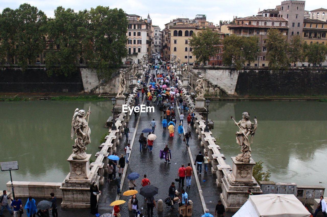High Angle View Of People Walking On Bridge Over River During Rainy Season