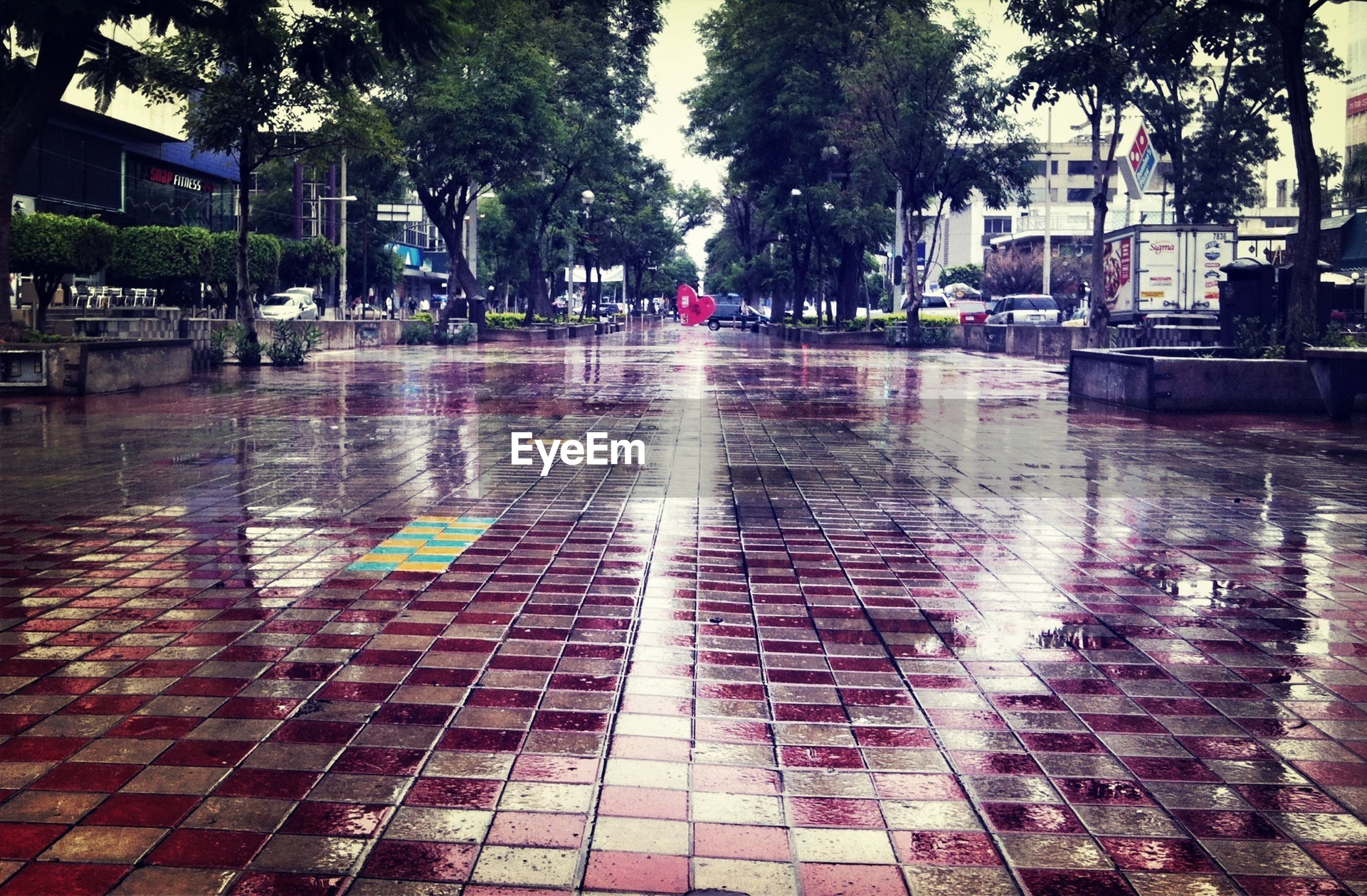 Wet footpath in city