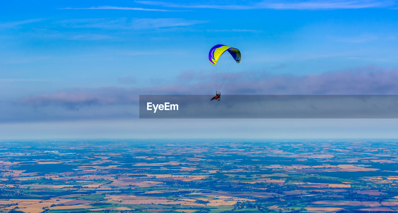 adventure, extreme sports, sport, flying, mid-air, paragliding, sky, parachute, beauty in nature, real people, leisure activity, cloud - sky, freedom, unrecognizable person, nature, transportation, scenics - nature, day, joy, one person, outdoors, skydiving