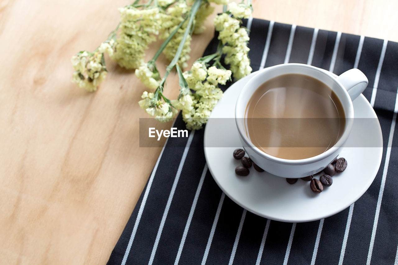 food and drink, freshness, high angle view, table, drink, cup, refreshment, still life, mug, coffee, coffee cup, food, saucer, coffee - drink, crockery, indoors, plant, no people, flower, flowering plant, non-alcoholic beverage, tea cup