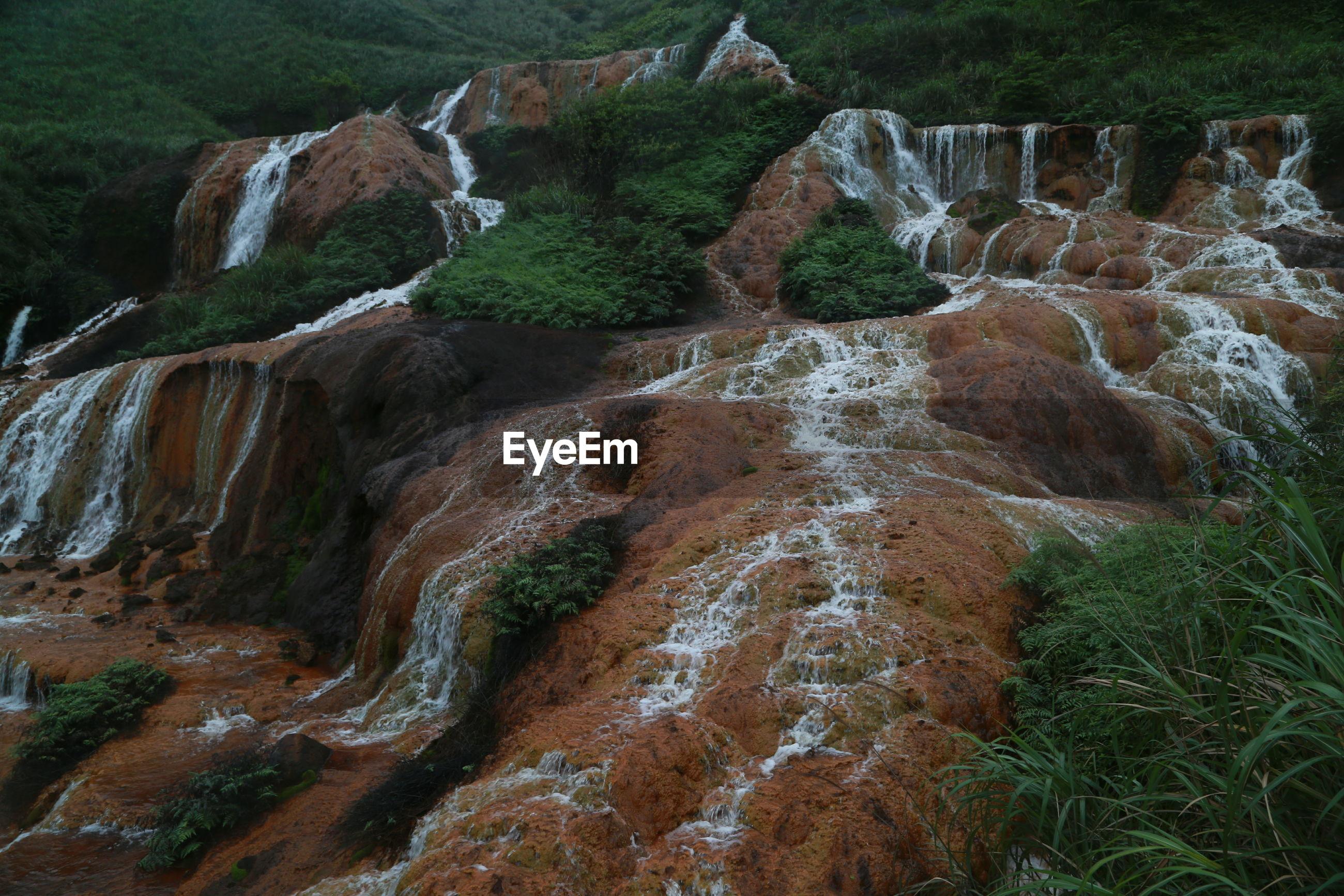 High angle view of waterfall through rocks
