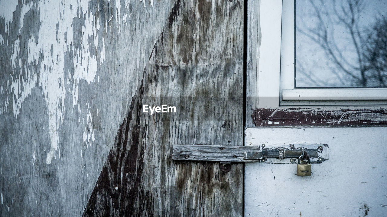 door, no people, wood - material, entrance, day, building exterior, window, close-up, safety, built structure, architecture, outdoors, closed, metal, security, protection, old, lock, wall - building feature, abandoned, latch