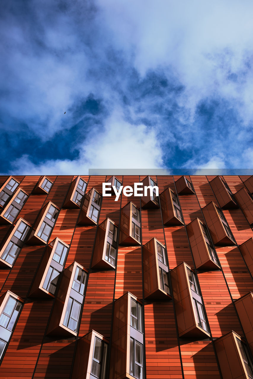 sky, cloud - sky, built structure, architecture, building exterior, low angle view, no people, building, nature, day, outdoors, window, pattern, city, brown, sunlight, blue, roof, orange color, red, apartment