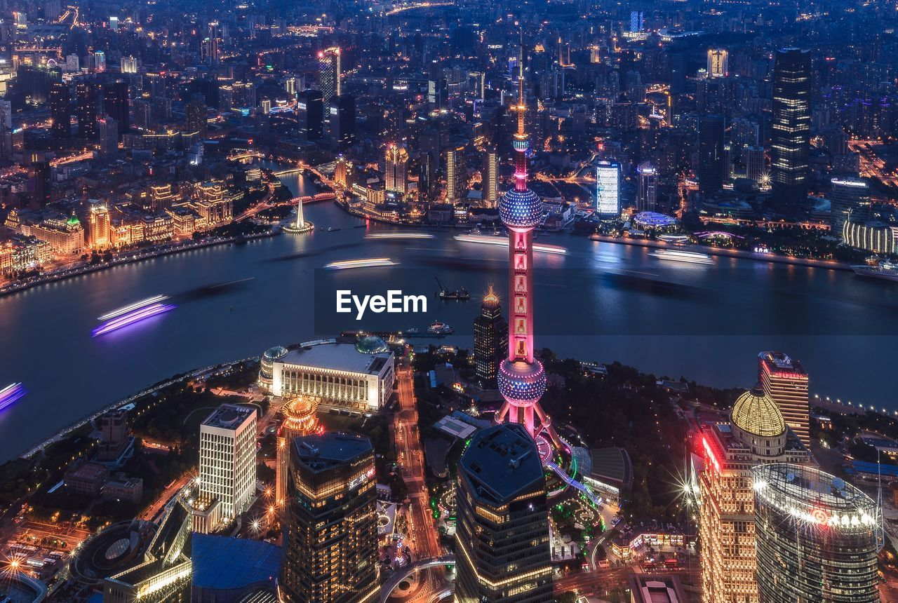 High Angle View Of Oriental Pearl Tower And Huangpu River In City At Night