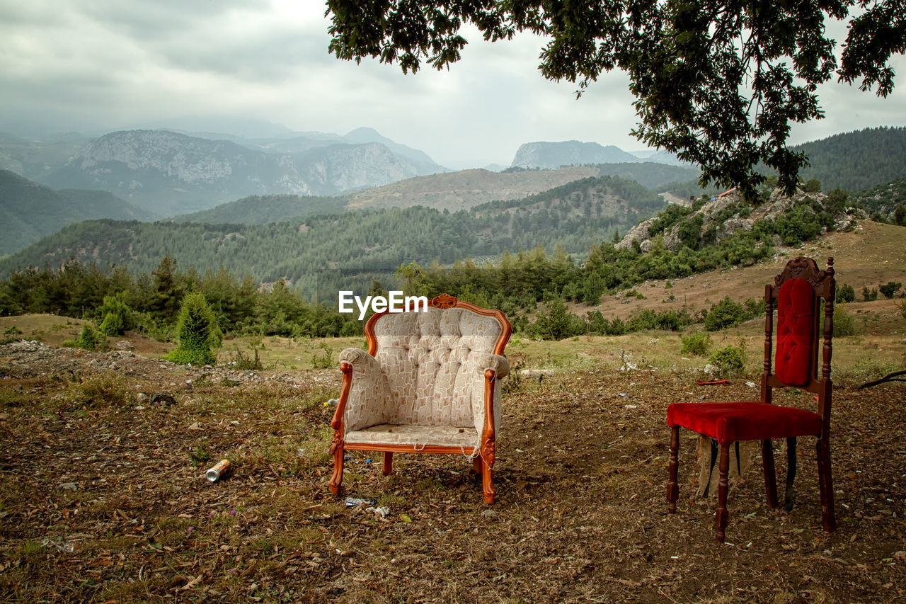 mountain, tree, seat, plant, scenics - nature, beauty in nature, sky, landscape, tranquility, nature, chair, tranquil scene, land, mountain range, environment, day, non-urban scene, idyllic, no people, absence, outdoors
