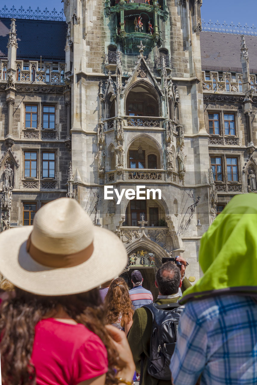 built structure, architecture, building exterior, group of people, real people, rear view, clothing, lifestyles, hat, crowd, city, people, day, women, adult, men, building, leisure activity, headshot, outdoors