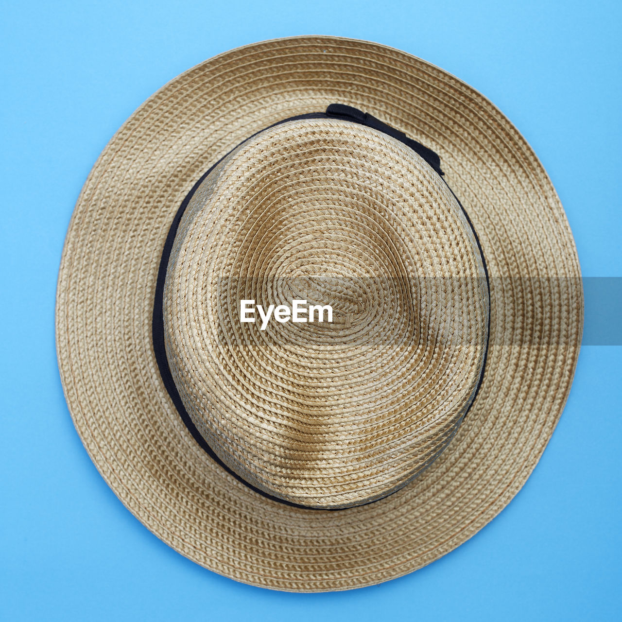 Close-up of hat against blue background