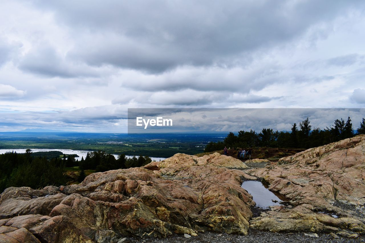 cloud - sky, sky, rock, scenics - nature, rock - object, beauty in nature, solid, tranquil scene, nature, tranquility, day, non-urban scene, environment, no people, water, landscape, plant, land, outdoors