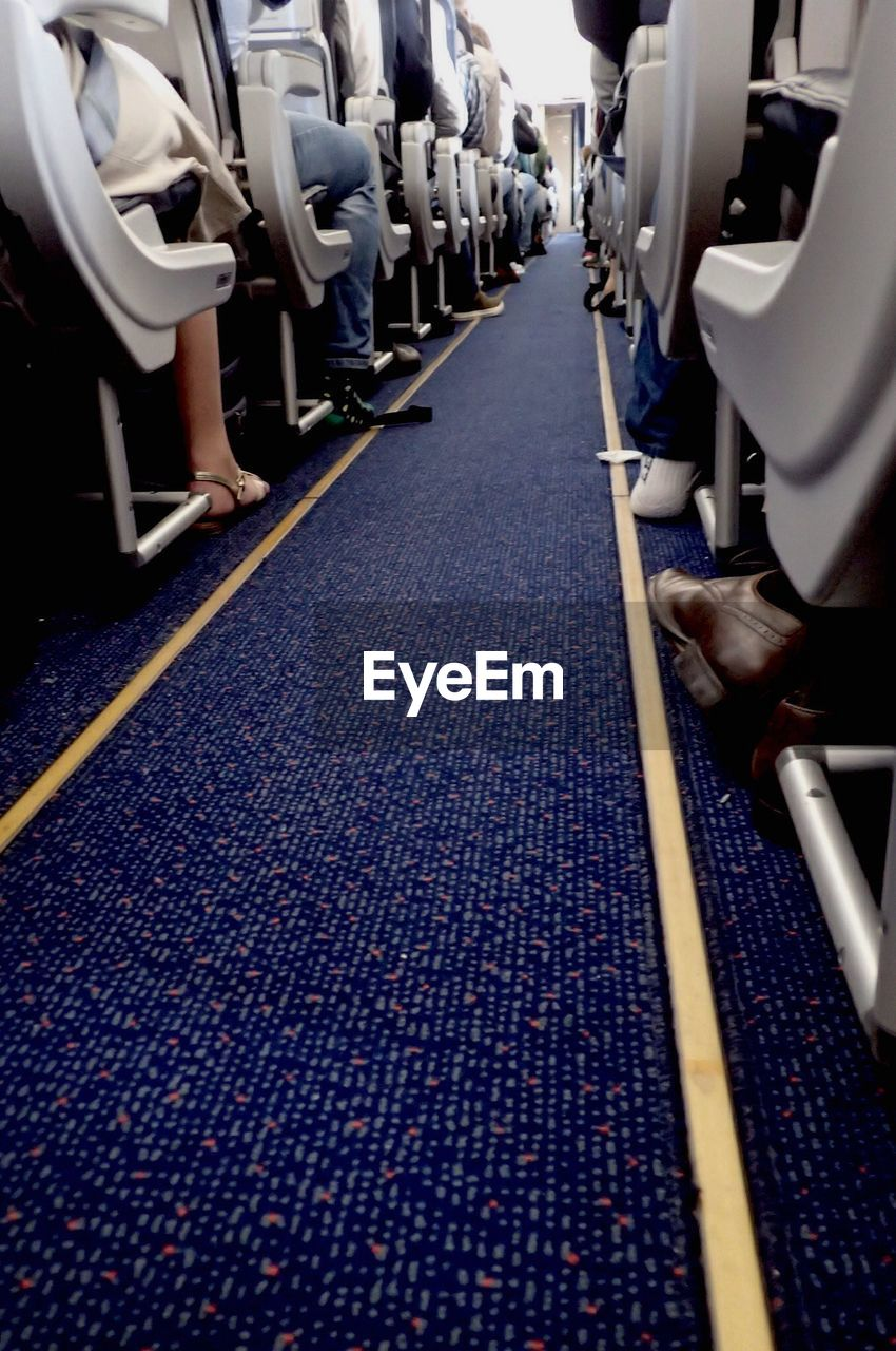 in a row, transportation, indoors, vehicle seat, day, no people