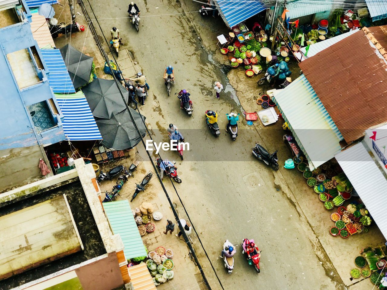 High Angle View Of People At Market In City